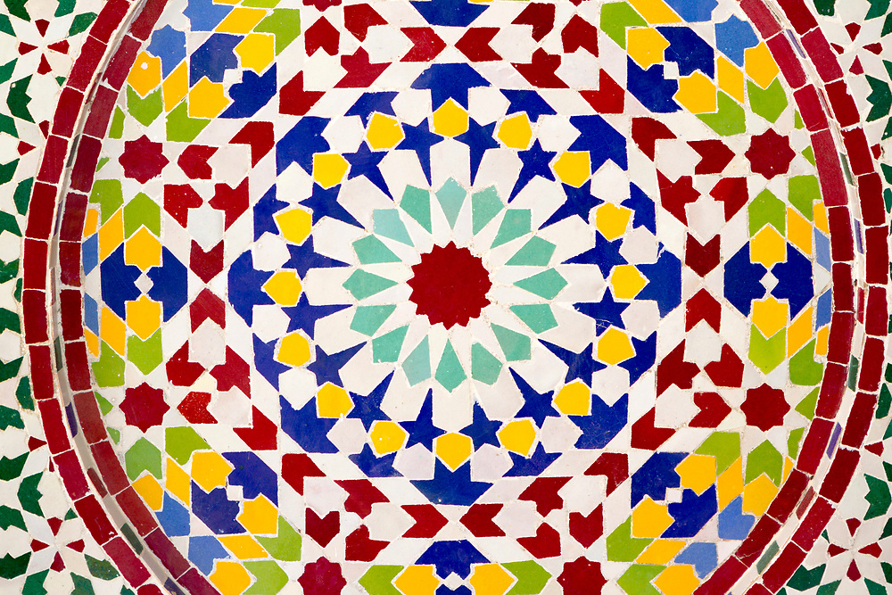 Close up of intricate mosaic zelij tiling work on an indoor fountain inside a riad in Fez (Fes) el Bali Media, Morocco, 2013-10-24.<br />