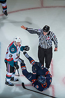 KELOWNA, CANADA - FEBRUARY 24:  Luc Smith #24 of the Kamloops Blazers charges Dillon Dube #19 of the Kelowna Rockets at the puck drop on February 24, 2018 at Prospera Place in Kelowna, British Columbia, Canada.  (Photo by Marissa Baecker/Shoot the Breeze)  *** Local Caption ***