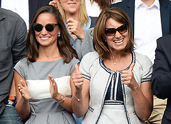 Image licensed to i-Images Picture Agency. 06/07/2014. London, United Kingdom. Pippa Middleton and her mother Carole celebrate a point at the Wimbledon Men's Final.  Picture by Andrew Parsons / i-Images