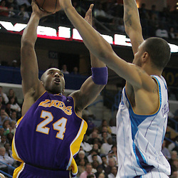 12 November 2008: Los Angeles Lakers guard Kobe Bryant (24) shoots over New Orleans Hornets center Tyson Chandler (6) during a NBA regular season game between the Los Angeles Lakers and the New Orleans Hornets at at the New Orleans Arena in New Orleans, LA..