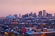 Skyline of New Orleans and the iconic round Superdome is illuminated at dawn.