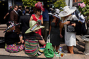 Ladies in hats enjoy morning drinks bar during the annual Royal Ascot horseracing festival in Berkshire, England. Royal Ascot is one of Europe's most famous race meetings, and dates back to 1711. Queen Elizabeth and various members of the British Royal Family attend. Held every June, it's one of the main dates on the English sporting calendar and summer social season. Over 300,000 people make the annual visit to Berkshire during Royal Ascot week, making this Europe's best-attended race meeting with over £3m prize money to be won.