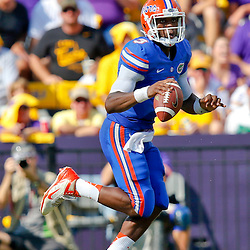 Oct 12, 2013; Baton Rouge, LA, USA; Florida Gators quarterback Tyler Murphy (3) against the LSU Tigers during the first half of a game at Tiger Stadium. Mandatory Credit: Derick E. Hingle-USA TODAY Sports