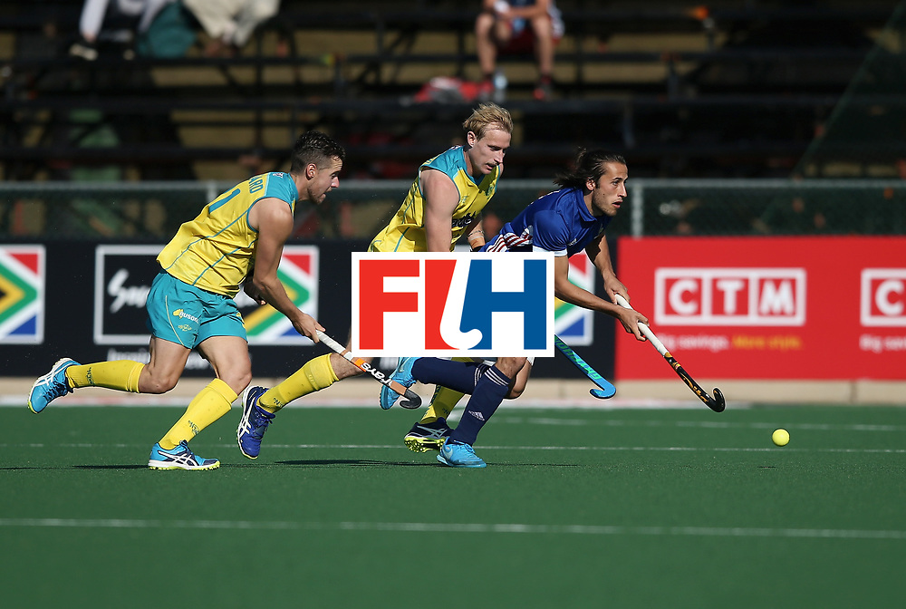 JOHANNESBURG, SOUTH AFRICA - JULY 11: Charles Masson of France breaks away from Aran Zalewski and Josh Pollard of Australia during day 2 of the FIH Hockey World League Semi Finals Pool A match between Australia and France at Wits University on July 11, 2017 in Johannesburg, South Africa. (Photo by Jan Kruger/Getty Images for FIH)