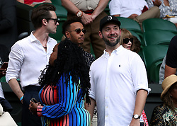 Lewis Hamilton (centre), Anna Wintour and Alexis Ohanian in the players box of centre court on day twelve of the Wimbledon Championships at the All England Lawn Tennis and Croquet Club, Wimbledon.