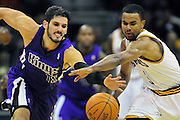 Oct. 30, 2010; Cleveland, OH, USA; Sacramento Kings small forward Omri Casspi (18) and Cleveland Cavaliers point guard Ramon Sessions (3) fight for a loose ball during the third quarter at Quicken Loans Arena. The Kings beat the Cavaliers 107-104. Mandatory Credit: Jason Miller-US PRESSWIRE