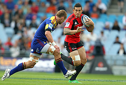 Sonny Bill Williams looks to beat Jarrad Hoeata..Investec Super Rugby - Highlanders v Crusaders, 19 March 2011, Carisbrook Stadium, Dunedin, New Zealand..Photo: Rob Jefferies / www.photosport.co.nz