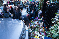 Highgate, London, December 26th 2016. Fans gather outside the London home of pop icon George Michael who died on Christmas day. PICTURED: Mourners lay flowers at the gate.