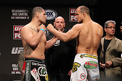 November 11, 2011; Santa Monica, CA; USA; UFC heavyweight champion Cain Velasquez (l) and challenger Junior Dos Santos (r) pose after weighing in for their upcoming fight.  The two will meet on Saturday night in the main event at the Honda Center in Anaheim, CA.