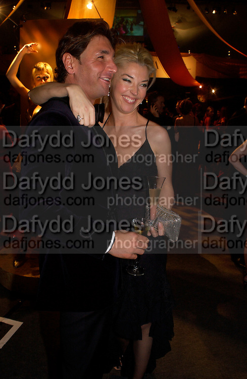 Giorgio Veroni and Tamara Beckwith, Dolce Vita party, Hon Artillery company,  London. 11 December 2003.  © Copyright Photograph by Dafydd Jones 66 Stockwell Park Rd. London SW9 0DA Tel 020 7733 0108 www.dafjones.com
