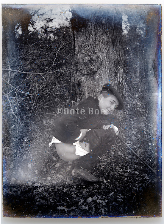 circa 1920s man defecating in the woods