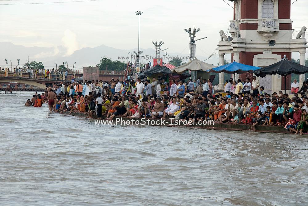 India, Uttarakhand, Haridwar Pilgrims bathing in the Ganges River