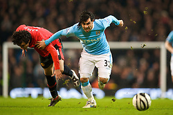 MANCHESTER, ENGLAND - Tuesday, January 19, 2010: Manchester City's Carlos Tevez in action against Manchester United during the Football League Cup Semi-Final 1st Leg at the City of Manchester Stadium. (Photo by David Rawcliffe/Propaganda)