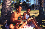 Couple with ukulele, Waikiki, Oahu, Hawaii (editorial use only, no model release)<br />