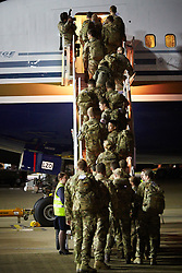 © Licensed to London News Pictures.  21/10/2014. CARTERTON, UK. Over 100 medics from 35 Squadron, 5 Medical Regiment depart from RAF Brize Norton for Freetown in Sierra Leone as part of the UK's response to the Ebola outbreak. The unit will man the Ebola Training Academy, training the local health care workers who staff the five treatment centres currently being built by the UK. <br /> <br /> In this picture: Medics board a Boeing 767 for the flight to Freetown. <br /> <br /> Photo credit: Cliff Hide/LNP