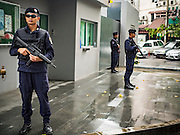 15 NOVEMBER 2015 - BANGKOK, THAILAND: Royal Thai Police at the gate of the French Embassy in Bangkok, Thailand. Security was heightened at the embassy after terrorists attacked civilian targets in Paris, France, on Nov. 13. The terrorists, affiliated with IS/ISIL killed more than 120 people. People left flowers at the gate to the embassy.         PHOTO BY JACK KURTZ