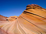 "Scene from the North Coyote Buttes area known as ""The Wave,"" Vermillion Cliffs National Monument, Arizona, known for its beautiful rock formations."