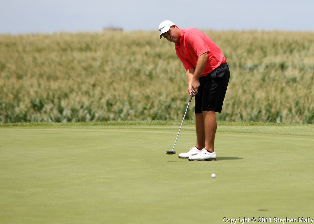 Kyle Peterman of Chatham, Illinois watches his putt on the 6th hole in first round of the Greater Cedar Rapids Open held at Hunters Ridge Golf Course in Marion on Friday, July 22, 2011.