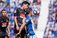 Javi Lopez of RCD Espanyol competes for the ball with Alexander Szymanowski of Club Deportivo Leganes during the match of La Liga between  Club Deportivo Leganes and RCD Espanyol at Butarque  Stadium  in Leganes, Spain. April 16, 2017. (ALTERPHOTOS / Rodrigo Jimenez)