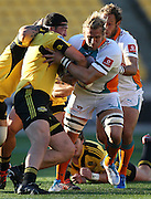 Cheetahs' Justin Downey is tackled by Hurricanes' Jeffery Toomaga-Allen during the 2012 Super Rugby season, Hurricanes v Cheetahs at Westpac Stadium, Wellington, New Zealand on Saturday 31 March 2012. Photo: Justin Arthur / Photosport.co.nz