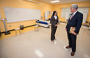 Memorial Hermann Chief Operating Officer Tom Flanagan, right, talks with student Brinajor Barrett, left, in the clinical classroom during the Hartman Middle School Health and Medical wing dedication, April 3, 2014.