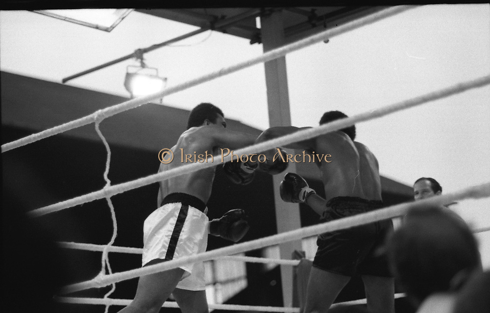 Ali vs Lewis Fight, Croke Park,Dublin.<br /> 1972.<br /> 19.07.1972.<br /> 07.19.1972.<br /> 19th July 1972.<br /> As part of his built up for a World Championship attempt against the current champion, 'Smokin' Joe Frazier,Muhammad Ali fought Al 'Blue' Lewis at Croke Park,Dublin,Ireland. Muhammad Ali won the fight with a TKO when the fight was stopped in the eleventh round.<br /> <br /> Both boxers throw wild swinging punches.