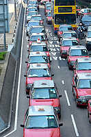 Taxis and traffic on Harcourt Road Hong Kong August 2008