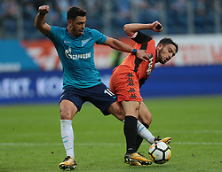 August 3, 2017 - Saint Petersburg, Russia - Giuliano (L) of FC Zenit Saint Petersburg and Stav Finish of FC Bnei Yehuda vie for the ball during the UEFA Europa League match, Third Qualifying Round, 2nd Leg between FC Zenit St. Petersburg and FC Bnei Yehuda at Saint Petersburg Stadium on August 03, 2017 in St. Petersburg, Russia. (Credit Image: © Igor Russak/NurPhoto via ZUMA Press)
