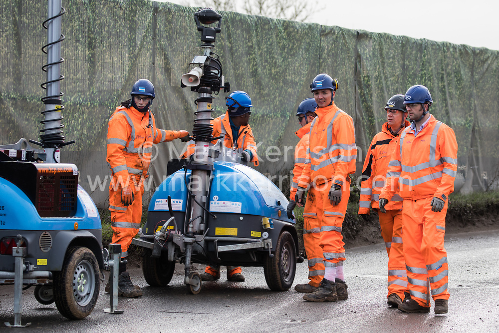 Harefield, UK. 8 February, 2020. HS2 engineers move equipment along Harvil Road in the Colne Valley to be used to facilitate the felling of trees for the high-speed rail link. Environmental activists from Save the Colne Valley, Stop HS2 and Extinction Rebellion based at a series of wildlife protection camps in the area prevented tree felling work, for which road and rail closures had been implemented, for the duration of the weekend over which it had been scheduled.