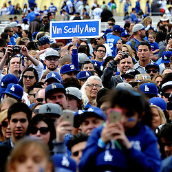 A fan holds up a sign &quot;Vin Scully Way&quot; as the Hall of fame broadcaster speaks during the fourth annual offseason FanFest on Saturday, Jan. 30, 2016 in Los Angeles. <br /> (Photo by Keith Birmingham/ Pasadena Star-News)