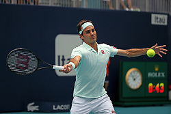 Roger Federer, of Switzerland, returns to John Isner, of the United States, during the final of the Miami Open tennis tournament at Hard Rock Stadium on Sunday, March 31, 2019, in Miami Gardens, Fla. Roger Federer won 6-1, 6-4. Photo by David Santiago/Miami Herald/TNS/ABACARESS.COM