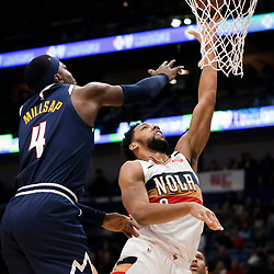 Jan 30, 2019; New Orleans, LA, USA; New Orleans Pelicans center Jahlil Okafor (8) shoots over nDenver Nuggets forward Paul Millsap (4) during the second half at the Smoothie King Center. Mandatory Credit: Derick E. Hingle-USA TODAY Sports