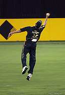 Australian fielder Michael Hussey takes a catch to dismiss Kyle Mills during the 5th ODI cricket match between the New Zealand Black Caps and Australia at the Gabba, Friday 13 February 2009 Brisbane, Australia. Photo: Andrew Cornaga/PHOTOSPORT