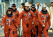 The crew of the Shuttle Discovery leave the Operations headquarters 30 October, 1989 wearing Halloween hats as they prepare to board the orbiter for launch training exercises. L to R: Mission Specialist Kathy Thornton, Mission Specialist Manley Carter, Commander Frederick Gregory, Mission Specialist Story Musgrave and Pilot John Blaha.