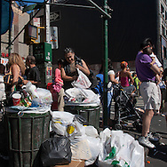 New York Canal street, Chinatown. chinese homeless woman searching in garbage,