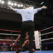 "Juan Castillo (white stripe) fights Luis Garcia during the ""Boxeo Telemundo"" boxing match at the Kissimmee Civic Center on Friday, March 14, 2014 in Kissimmme, Florida. (Photo/Alex Menendez)"