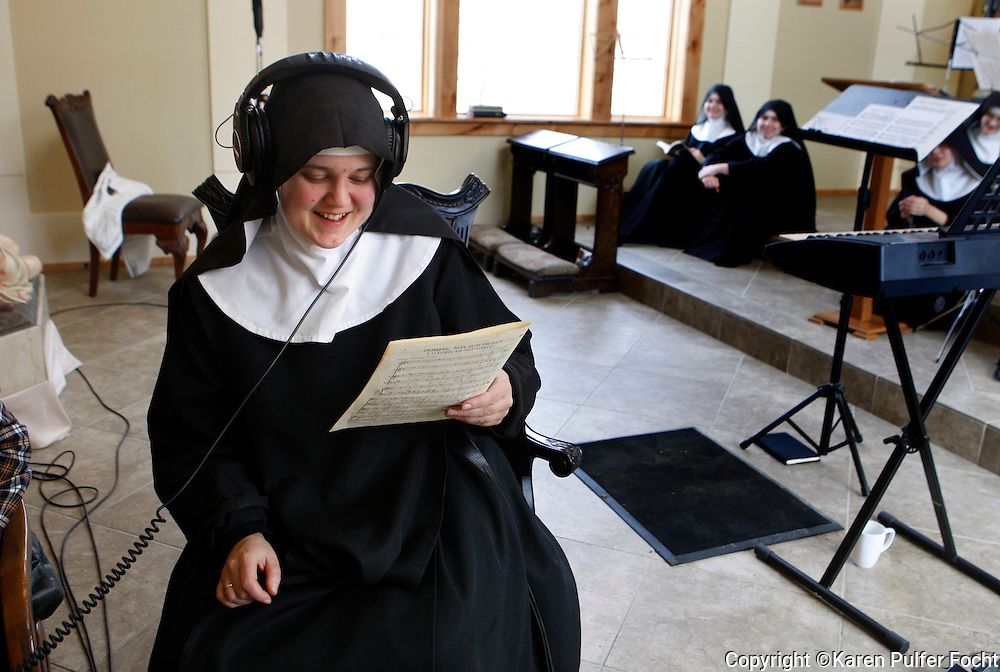 Mother Cecilia listens back to a recording while the singing nuns take a break. The Benedictines of Mary, Queen of the Apostles are cloistered nuns who have had four albums top the charts. They are releasing their latest album, Adoration at Ephesus, April 26, 2016.  The nuns recorded this album themselves, in their new chapel, in the quiet hills of Missouri where they farm, make vestments and spend their days in silence and prayer.
