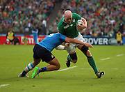 Captain tackling captain during the Rugby World Cup Pool D match between Ireland and Italy at the Queen Elizabeth II Olympic Park, London, United Kingdom on 4 October 2015. Photo by Matthew Redman.