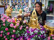 16 APRIL 2015 - BANGKOK, THAILAND:  People pray and make merit at a Buddhist alter set up for Songkran in Hua Lamphong train station in Bangkok. More than 130,000 passengers streamed through Bangkok's main train station in the days before and after Songkran, Thailand's traditional new year celebration. Songkran was celebrated April 13-15.    PHOTO BY JACK KURTZ