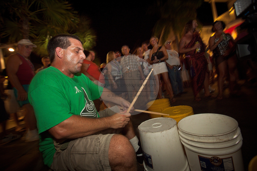 A street musician during Fantasy Fest halloween parade in Key West, Florida.