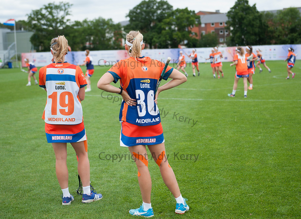 Netherlands spare players watch their warm up at the 2017 FIL Rathbones Women's Lacrosse World Cup, at Surrey Sports Park, Guildford, Surrey, UK, 14th July 2017.