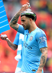 Manchester City's Kyle Walker celebrates with the trophy lid after winning the FA Cup Final at Wembley Stadium, London.