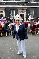 LOCATION, UK  29/04/2011. The Royal Wedding of HRH Prince William to Kate Middleton. Carry On actress Barbara Windsor stands in front of guests in Downing Street to celebrate the Royal Wedding. Guests at the party included people from the local community, local school children and charities who work with both the young and old. Photo credit should read Matt Cetti-Roberts/LNP. Please see special instructions. © under license to London News Pictures