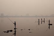 Fishermen on West Lake at dusk in Hanoi, Vietnam, Southeast Asia