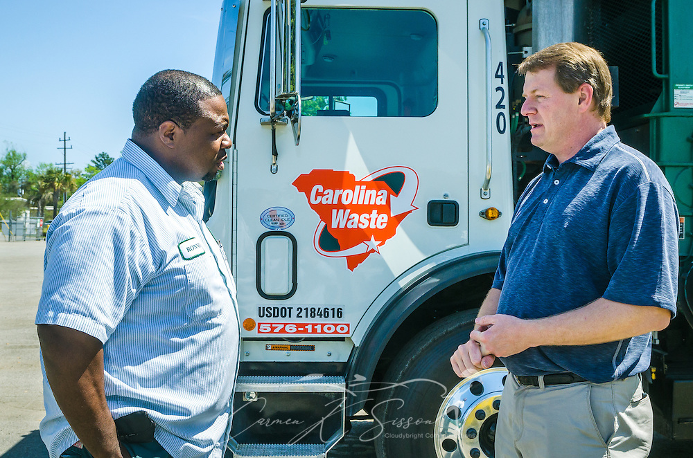 Scott Fennell, right, talks with a driver at Carolina Waste & Recycling LLC, April 6, 2015, in North Charleston, S.C. The company was founded in 2002 and is the largest independently owned waste hauling company in the state. (Photo by Carmen K. Sisson/Cloudybright)