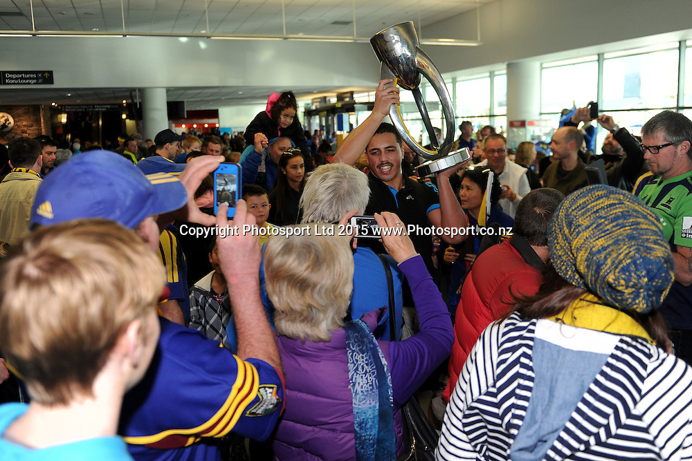 Daniel Lienert-Brown of the Highlanders holds the Super Championship trophy, during the Highlanders Airport Arrival after winning the Super Rugby Title, Dunedin Airport, Dunedin, New Zealand, 5 July 2015. Credit: Joe Allison / www.Photosport.co.nz
