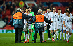 MANCHESTER, ENGLAND - Tuesday, February 12, 2019: A Manchester United steward series to stop Paris Saint-Germain's Marcos Aoás Corrêa 'Marquinhos' from walking towards the away supporters after the UEFA Champions League Round of 16 1st Leg match between Manchester United FC and Paris Saint-Germain at Old Trafford. PSG won 2-0. (Pic by David Rawcliffe/Propaganda)