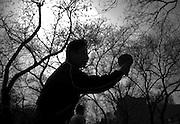 A man plays table tennis in a Beijing Park.