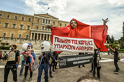 Actors from a greek puppet theatre association hold a giant puppet at the Syntagma square, in front of the Greek parliament, in central Athens, on May 7, 2020 during a demonstration organised by artists, musicians and actors to ask for help to the Greek government for the financial loses due to the lockdown aimed at curbing the spread of the COVID-19<br /> <br /> Pictured: <br /> Dimitris Lampropoulos  | EEm 7 May 2020