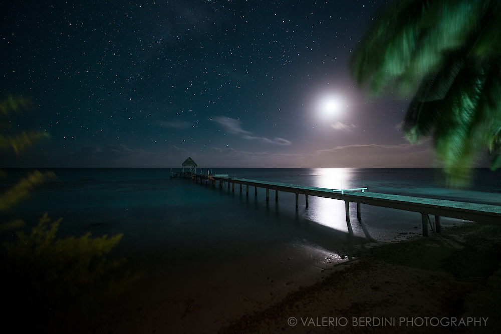 A pier seen at moonlight over the lagoon of Fakarava atoll.